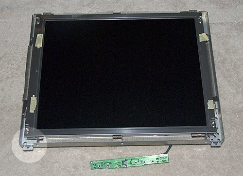 Figure 5 – LCD removed from the Case (Note: corner bracket – lower left)