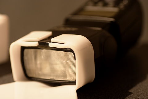 9. The little tabs are bent in slightly to prevent the diffuser sliding down the flash head