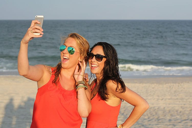 One of the best selfie tips is to look good in a photo (and avoid duck face).