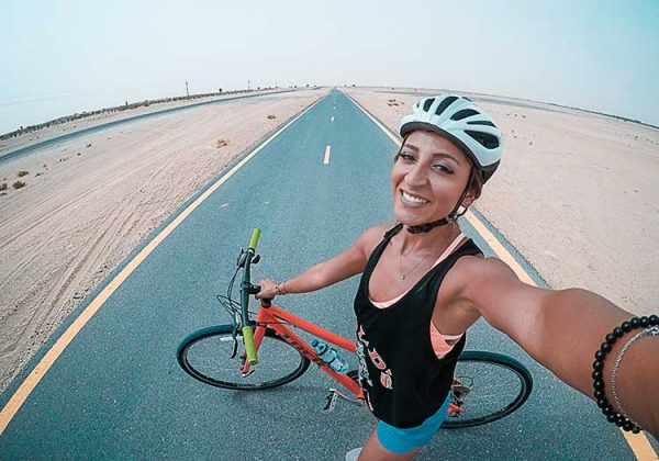 A cyclist is making selfie